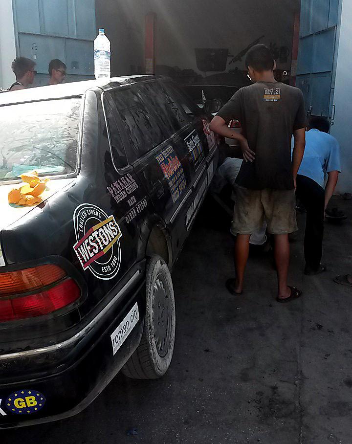 jacked-up-car