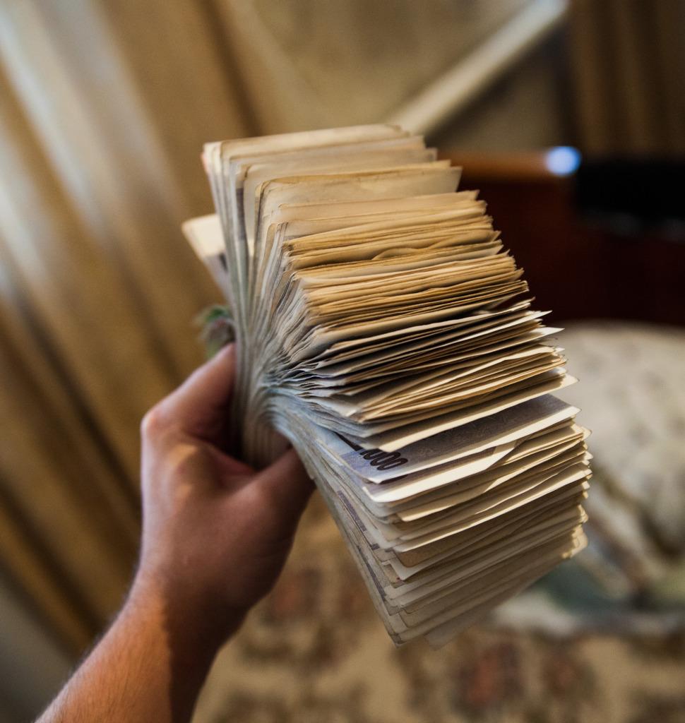 piles of uzbek cash